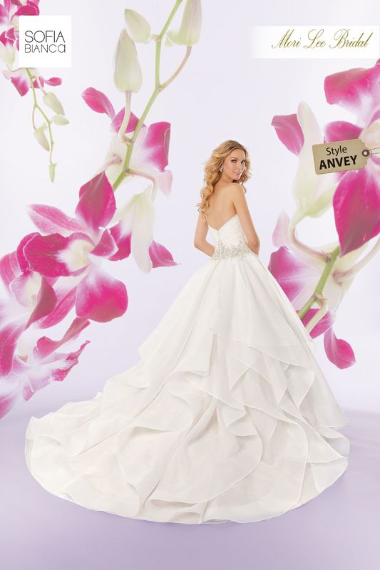 Style ANVEY Savannah  Intricately beaded embroidery on a draped organza bodice with horsehair edged, flounced ball gown skirt