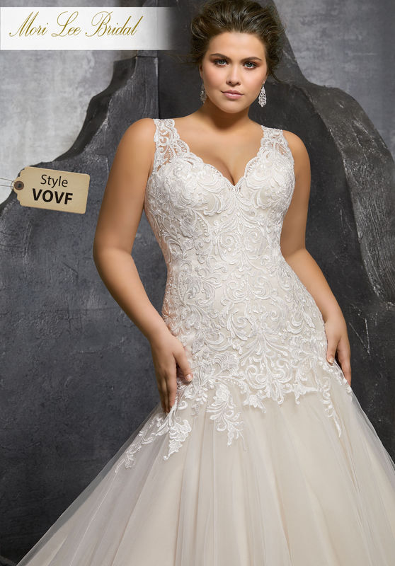 Style VOVF Kesara Wedding Dress  Elegant Modified A-Line Tulle Wedding Gown Featuring Frosted, Embroidered Lace Appliqués on the V-Neck Bodice. A Sheer Illusion Back Trimmed in Covered Buttons Completes the Look. Colors Available: White, Ivory, Ivory/Crème