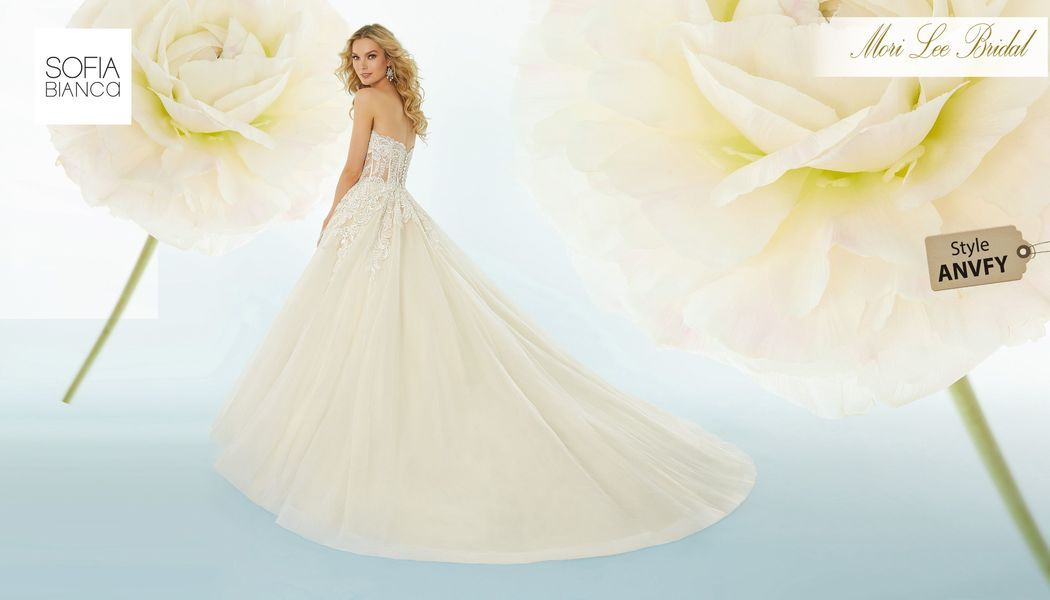 Style ANVFY Sabine  Crystel beaded, embroidered appliqués on a boned, corset bodice with tulle ball gown skirt  Matching satin bodice lining included