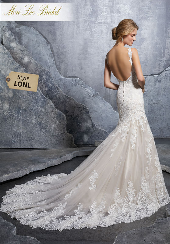 Style LONL  Krystal Wedding Dress  Elegant Fit and Flare Wedding Dress Featuring Frosted, Venice Lace and Embroidered Appliqués on Net with a Wide Scalloped Hemline. An Open Back Trimmed in Covered Buttons Trims the Back. Available in Three Lengths: 55″, 58″, 61″. Colors Available: White, Ivory, Ivory/Crème