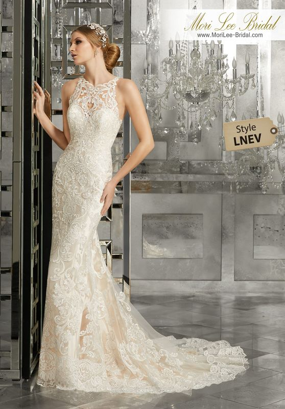 Style LNEV  Mimi Wedding Dress  Classic and Elegant, this Soft Fit and Flare Wedding Gown Features Sculptured, Embroidered Appliqués with a Scalloped Hemline and Sheer Train. A Breathtaking Illusion Back Accented with Covered Buttons Completes the Look. Available in Three Lengths: 55″, 58″, 61″. White, Ivory, Ivory/Light Gold.