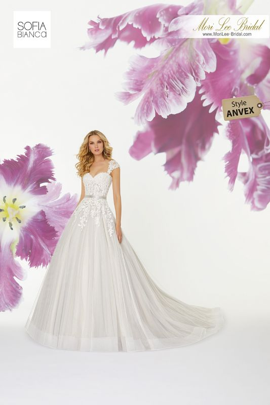 Style ANVEX Sabela  Crystal beaded, alençon lace appliqués on a soft net ball gown  Removable lace shoulder coverlet  Removable satin belt  Matching satin bodice lining included