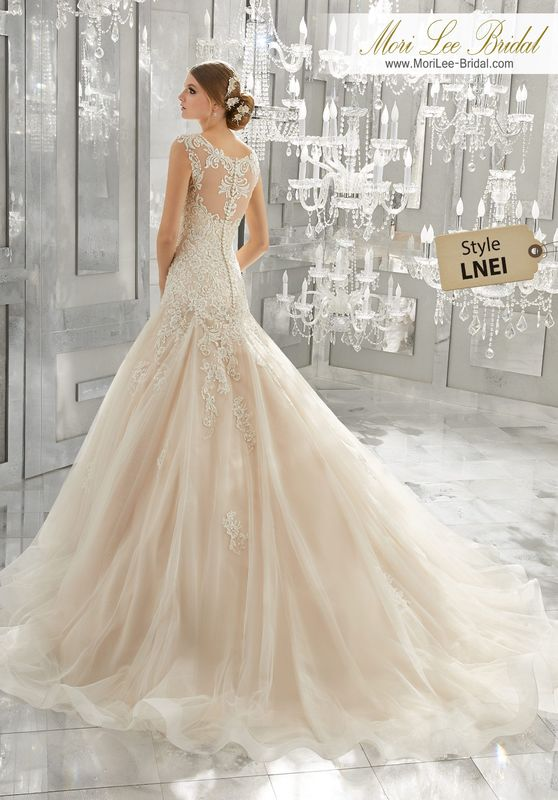Style LNEI  Monique Wedding Dress  This Timeless Beauty Features Crystal Beaded, Embroidered Appliqués on Soft Tulle and a Gored Skirt with Wide Horsehair Trim. An Elaborately Embroidered Illusion Back Accented with Covered Buttons Completes the Look. Available in Three Lengths: 55″, 58″, 61″ . Colors Available: White, Ivory, Ivory/Light Gold.