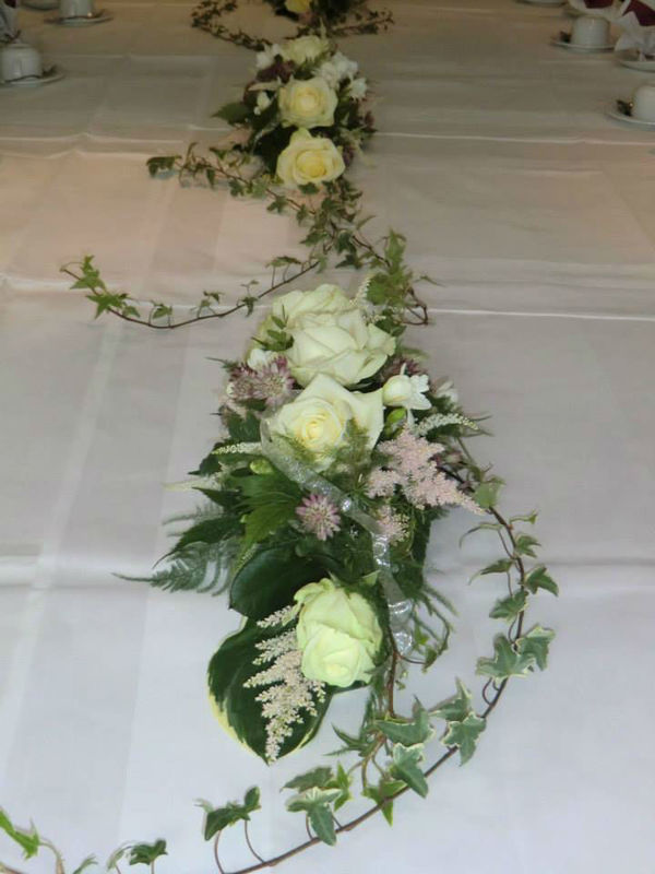 Beispiel: Tischdekoration, Foto: Blumenhaus Wasser.