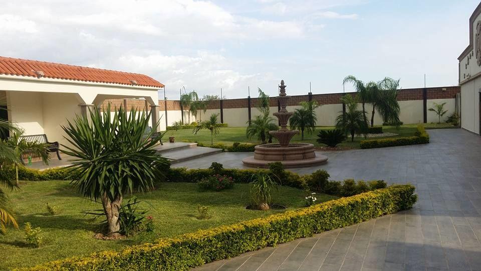 Aries Salón y Jardín